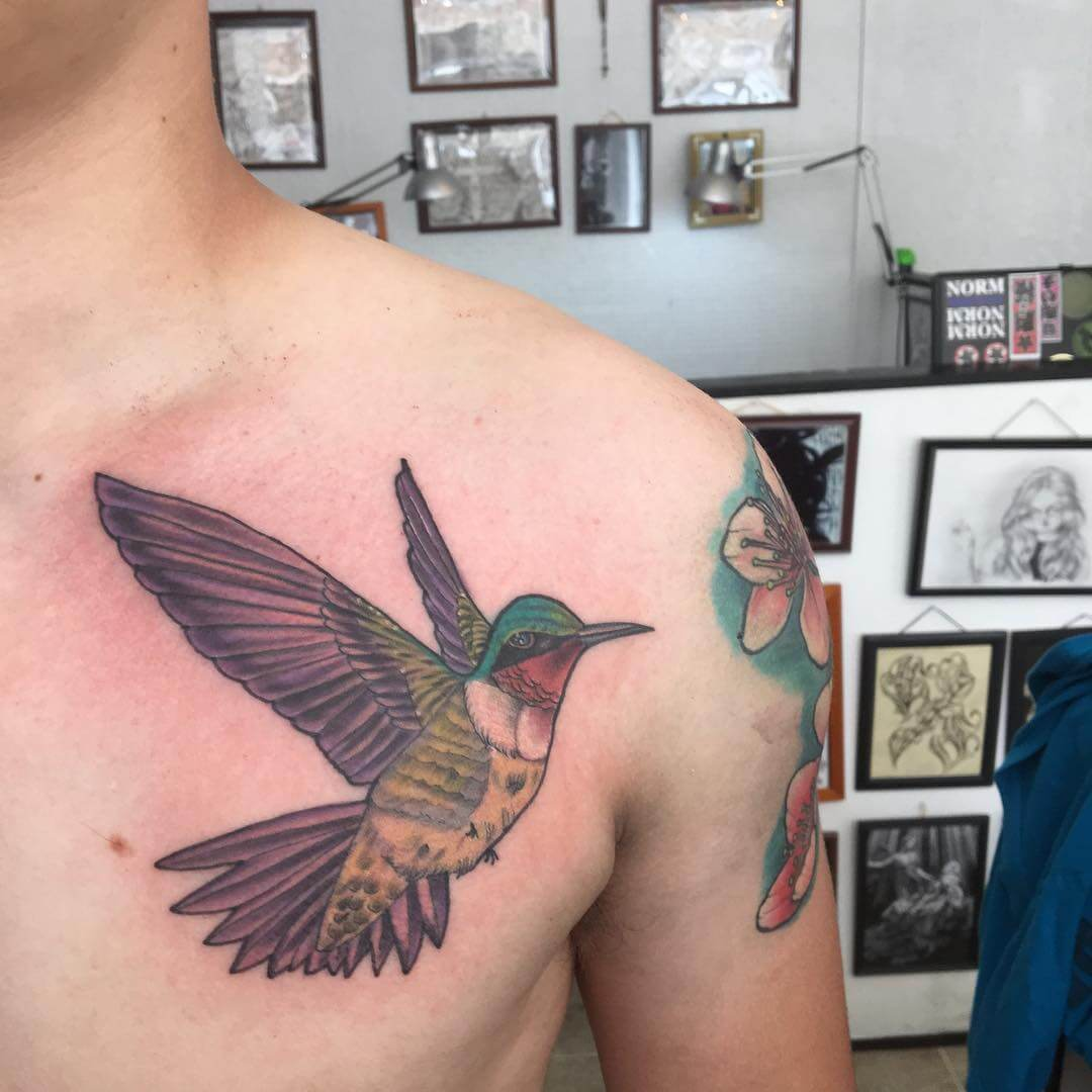 attractive hummingbird tattoo on chest 1