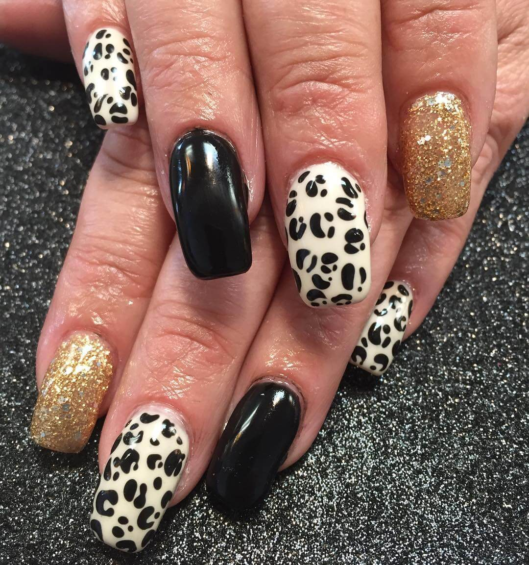 gold and black leopard nails 1