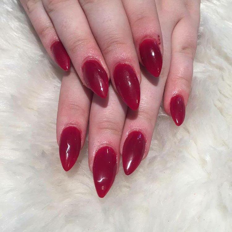 red pointed nail polish