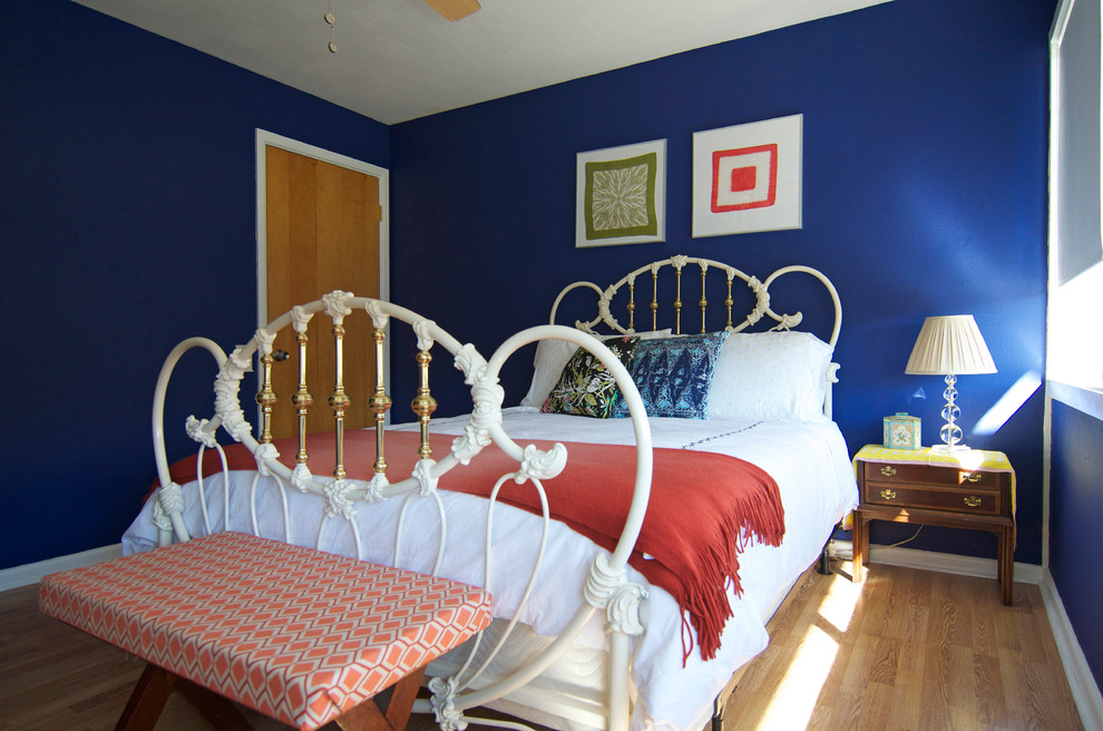 white and gold color bed with blue wall paint design