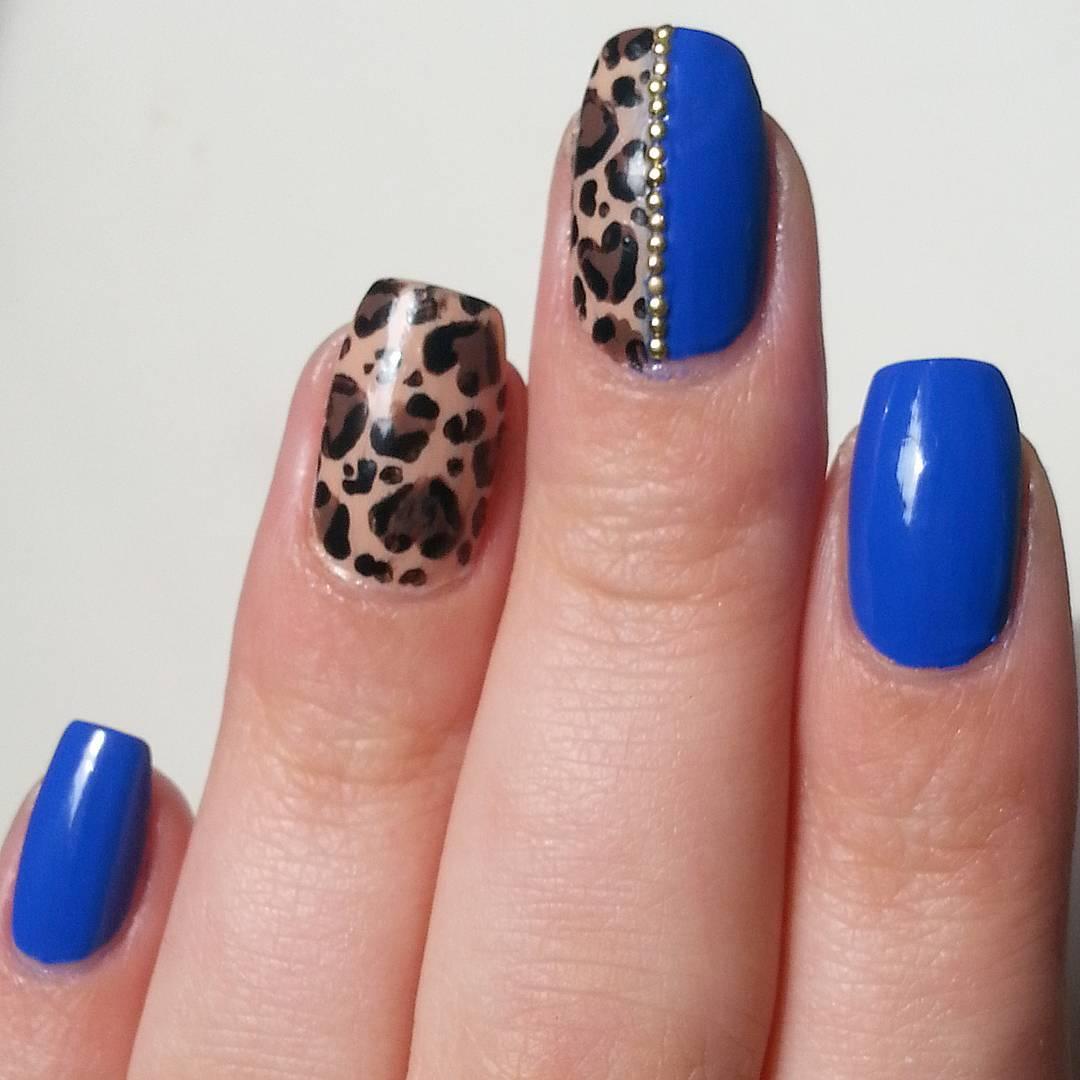 animal royal blue nail design