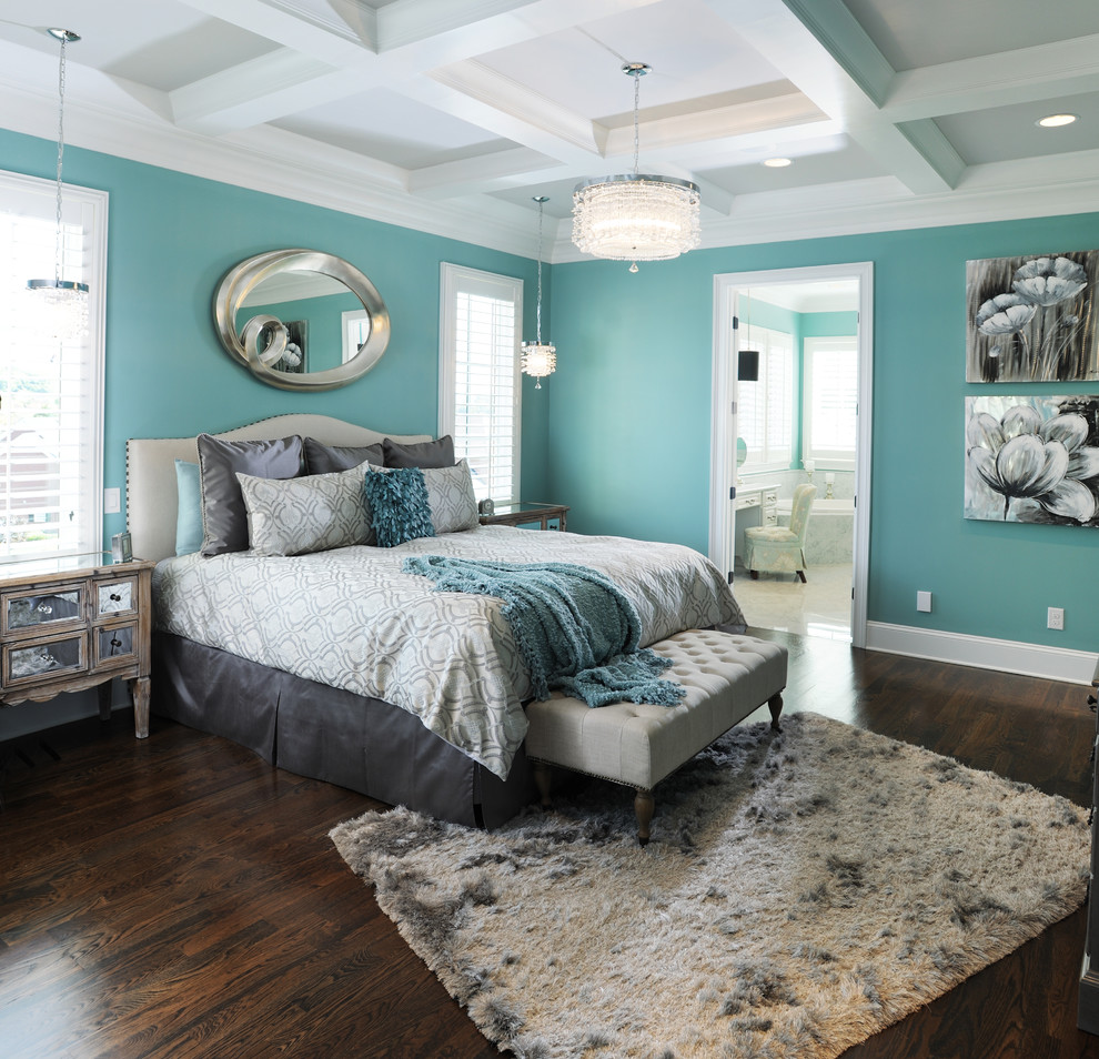 Master Bedroom With Blue Walls And Dark Hardwood Floors