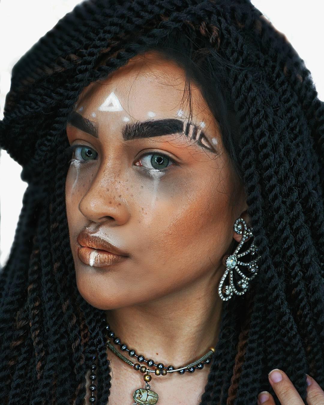 tribal makeup with senagalese twist hair