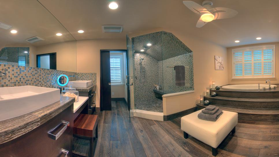 organic spa master bathroom with hardwood floors
