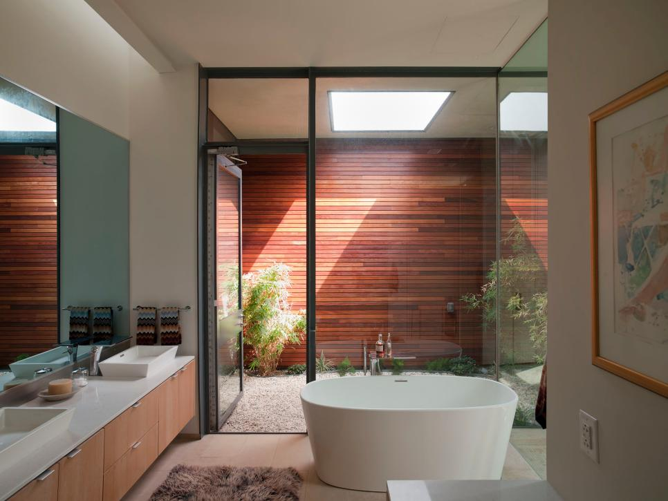 modern bathroom with glass wall soaking tub