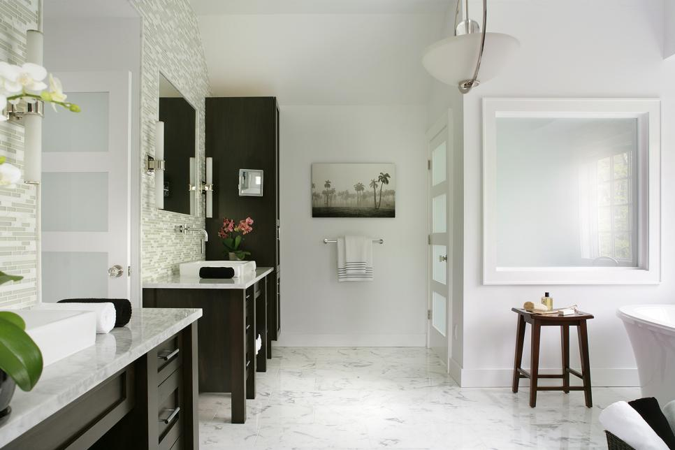bright tranquil bathroom boasts white marble floors