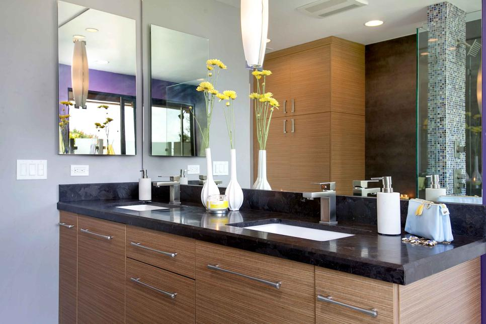 modern bathroom vanity with black marble countertop woodgrain cabinets and large mirror