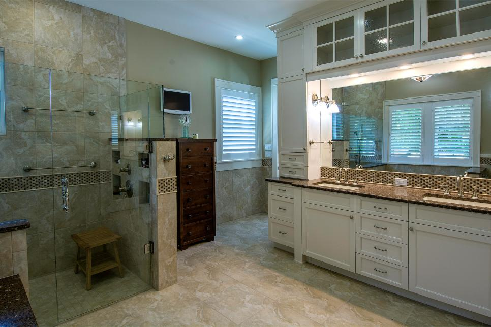 spa bathroom in soft cream and beige with overhead storage