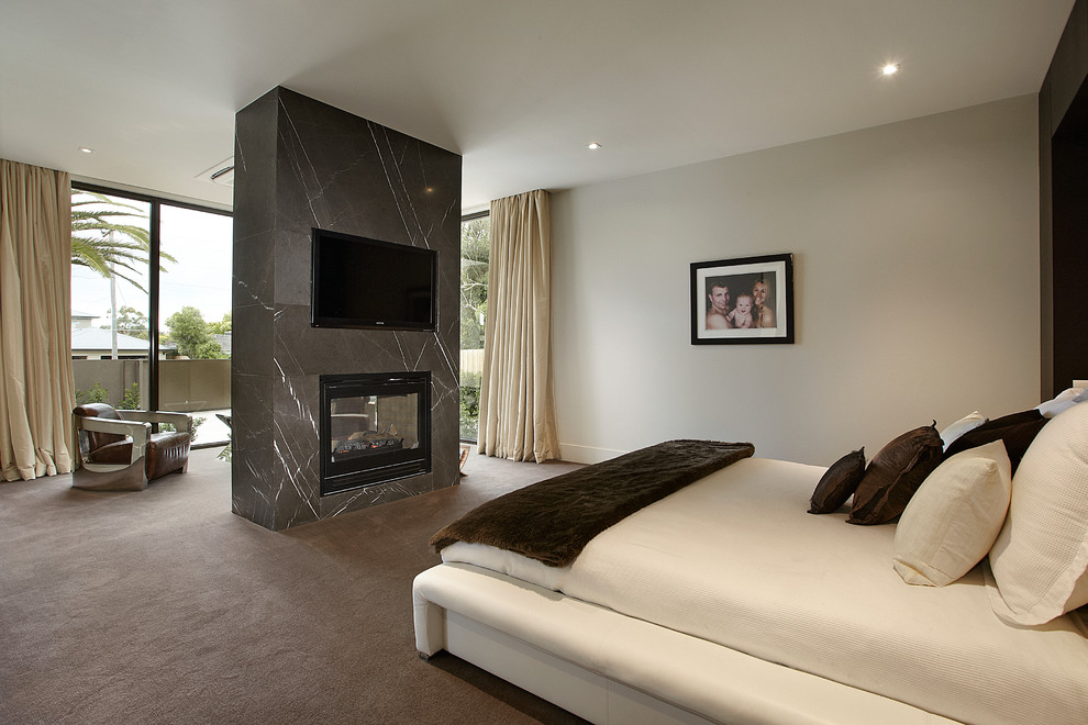 Contemporary Standing Fireplace Idea in Bedroom