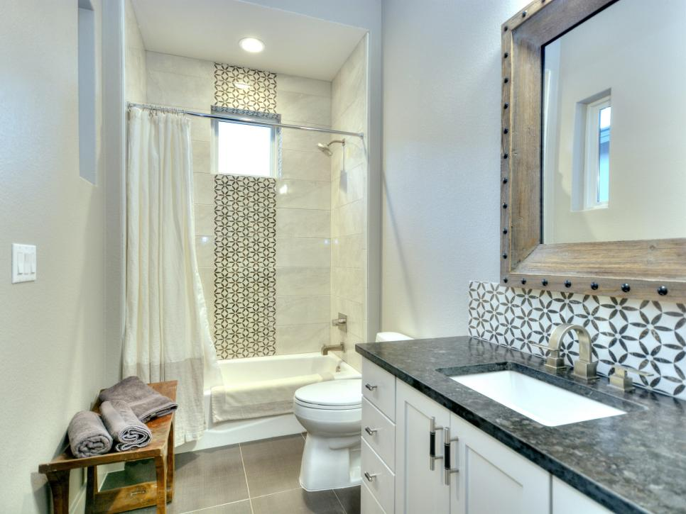 Transitional Bathroom Features Geometric Tile Design