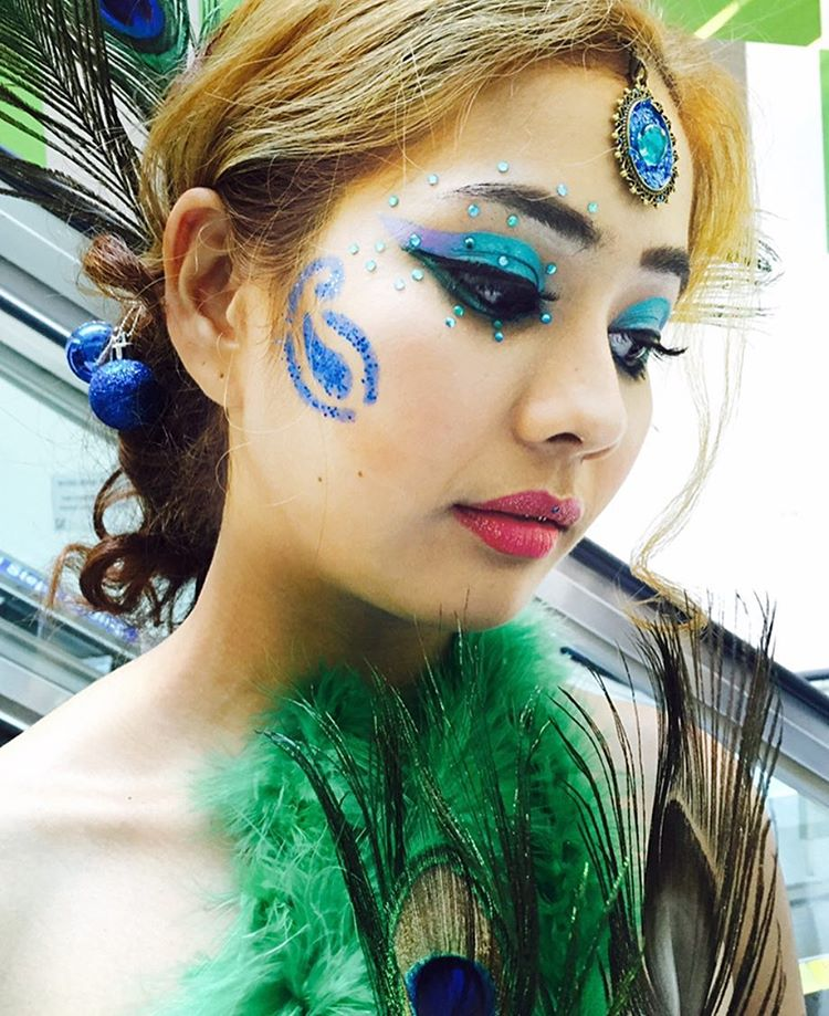 Creative Peacock Makeup Design For Women