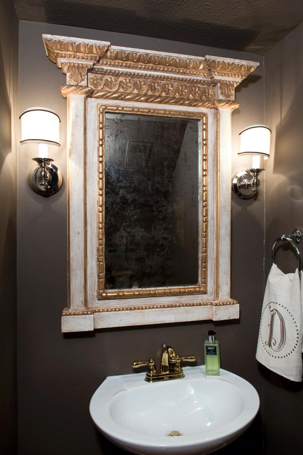 ornate bathroom mirror with charcoal gray walls