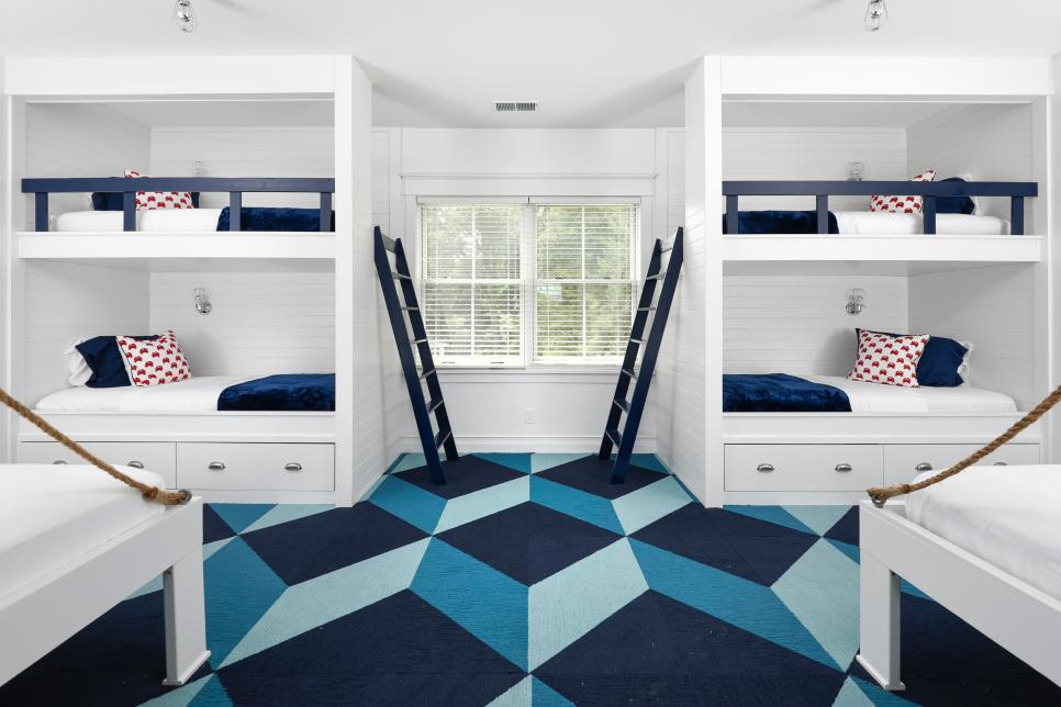 blue and white kids bedroom with geometric carpet