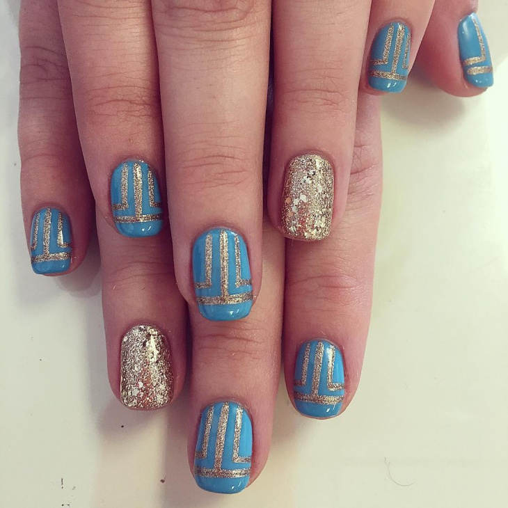 gold glitter and blue nail paint design