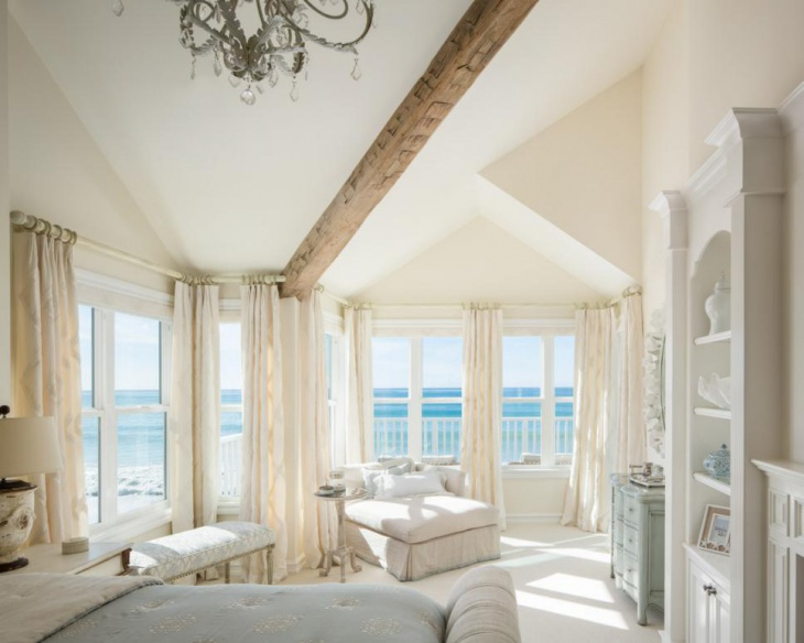 white master bedroom with modern furniture
