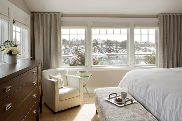 charming master bedroom has dark wood furniture1