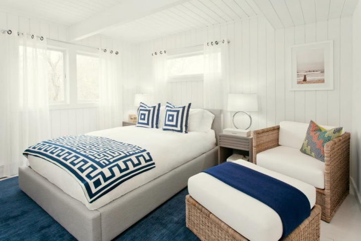 Navy Accents Master Bedroom with Warm Furniture