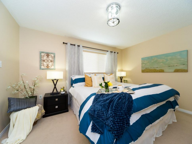 warm master bedroom with sleek furniture