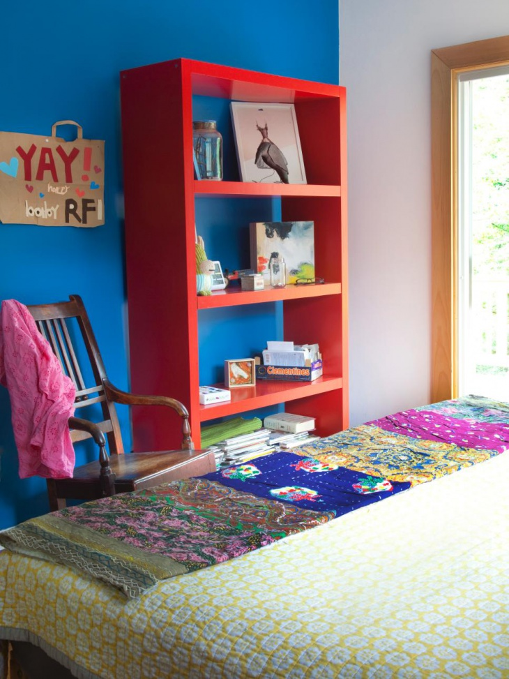 bedroom with painted wooden furniture