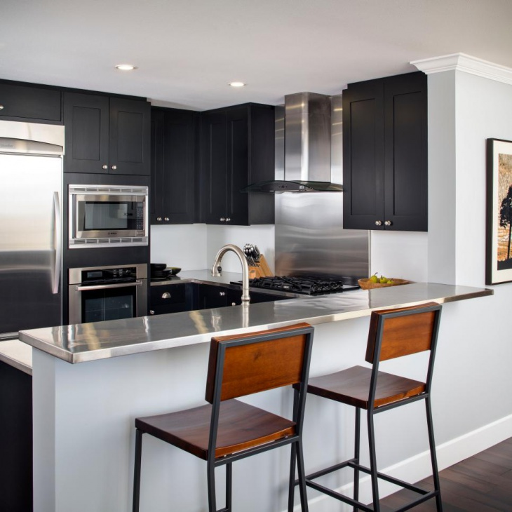 Kitchen With Black Cabinetry and Countertop
