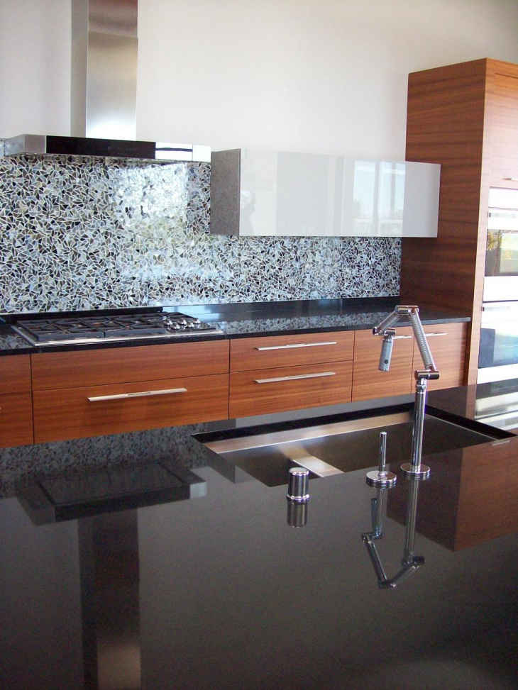 Sleek Kitchen With Black Granite Countertops
