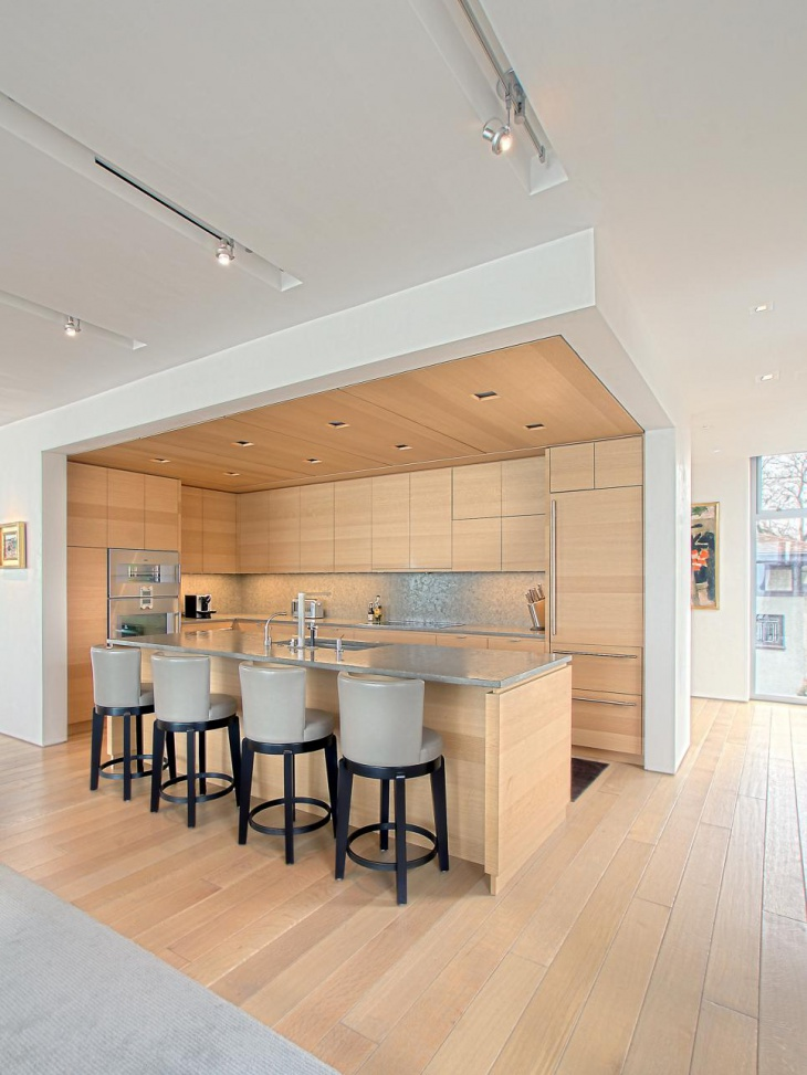 Modern Woodgrain Kitchen With Gray countertops and backsplash