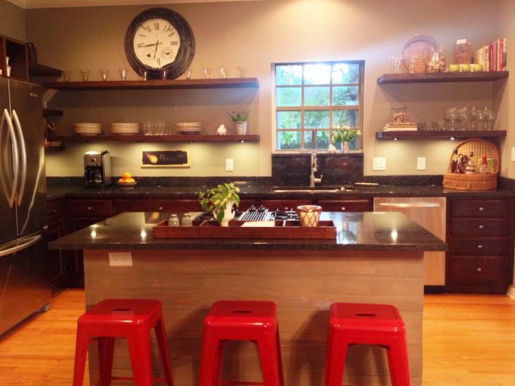 Black stone countertops pair with dark wood cabinets
