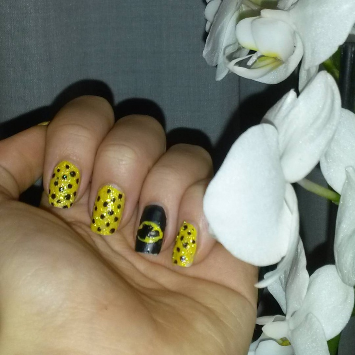 black dotted batman nail design