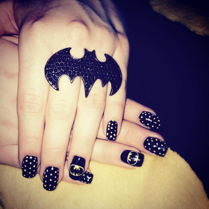 blue colored batman nail design
