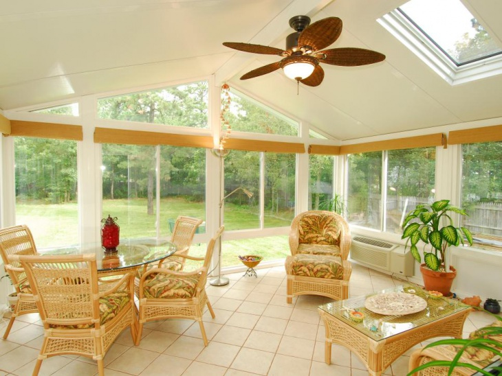 white cottage sunroom with tan wicker furniture