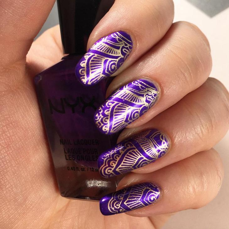 gold printed purple nail design