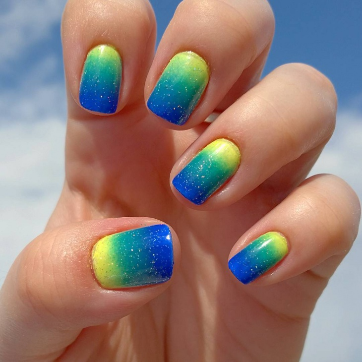 Blue and Yellow Sparkle Nail Design