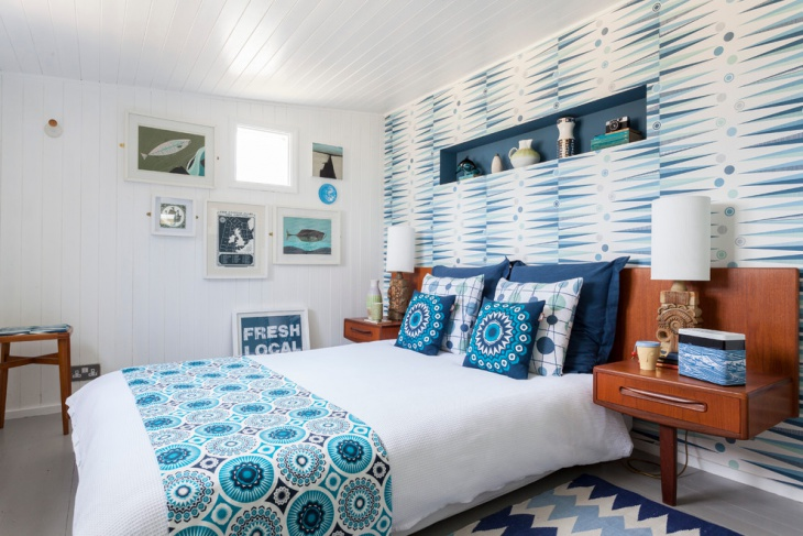 blue and white bedroom with teak bedside tables