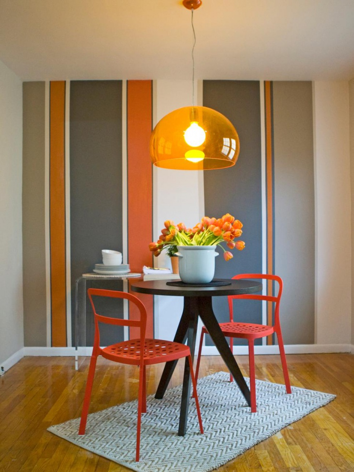 Striped Dining Room With Orange Pendant Light