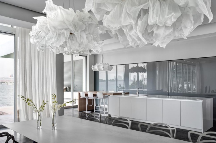 White Modern Dining Room With Cloud Pendants