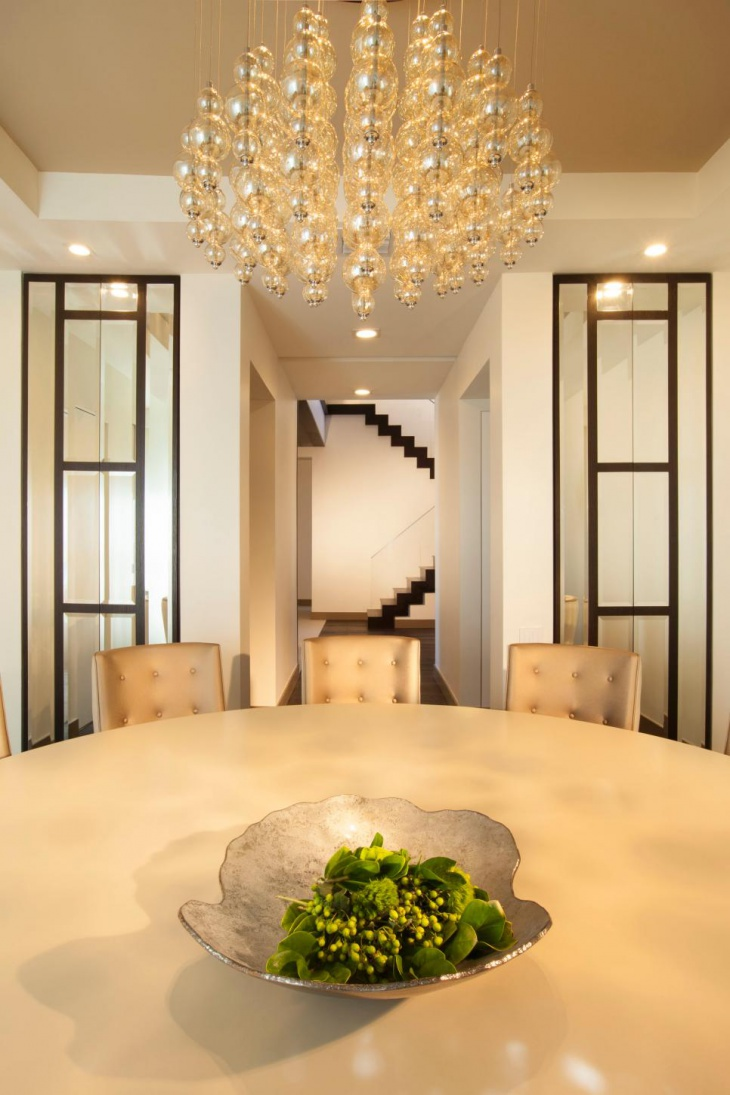Contemporary Dining Room With Metallic Pendant Chandelier