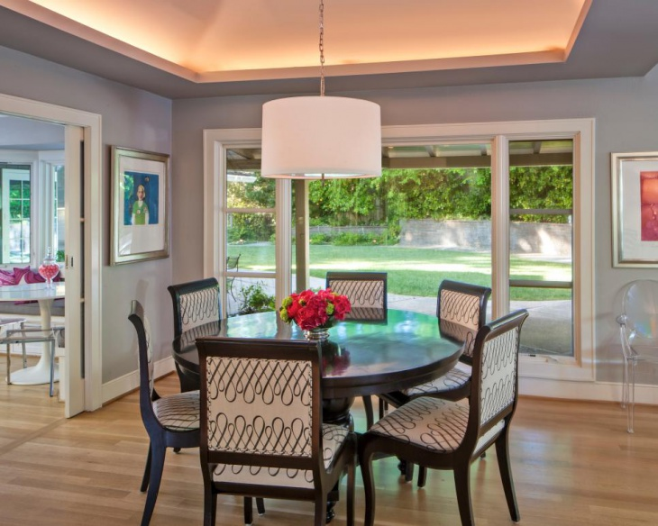 Transitional Dining Room With Stylish Drum Pendant