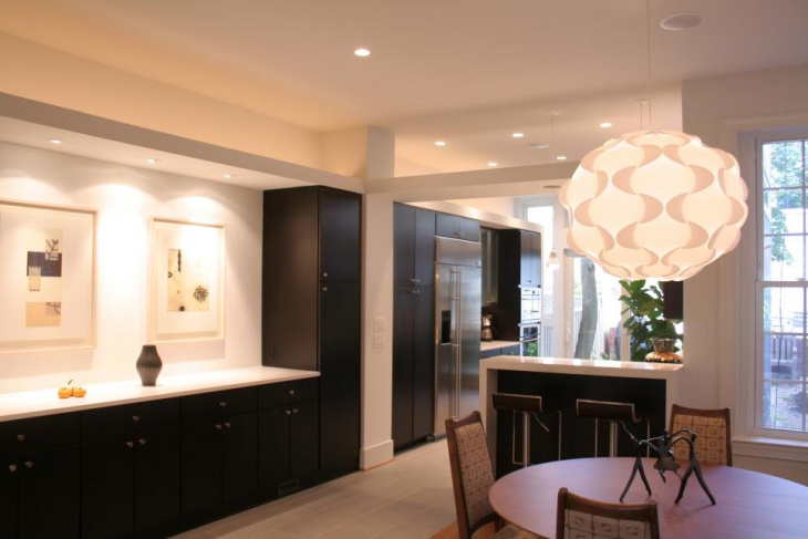 Contemporary Neutral Dining Room With Funky Pendant