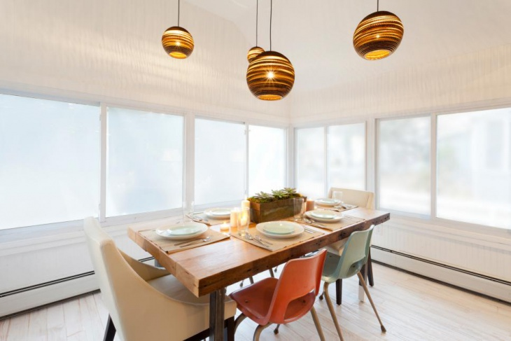 Custom Table and Unique Pendant Lights in Dining Room
