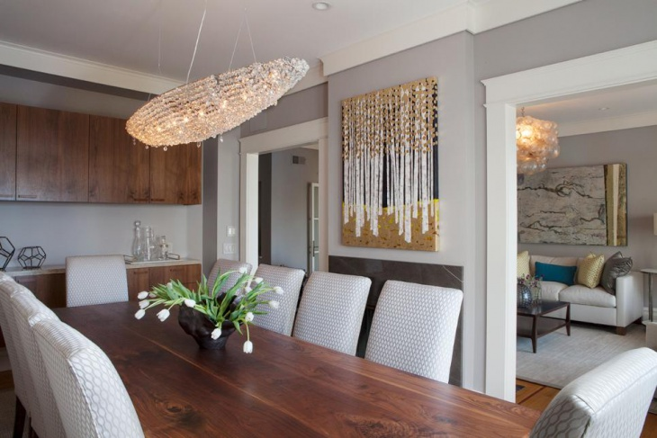 Transitional Dining Room With Crystal Light Fixture
