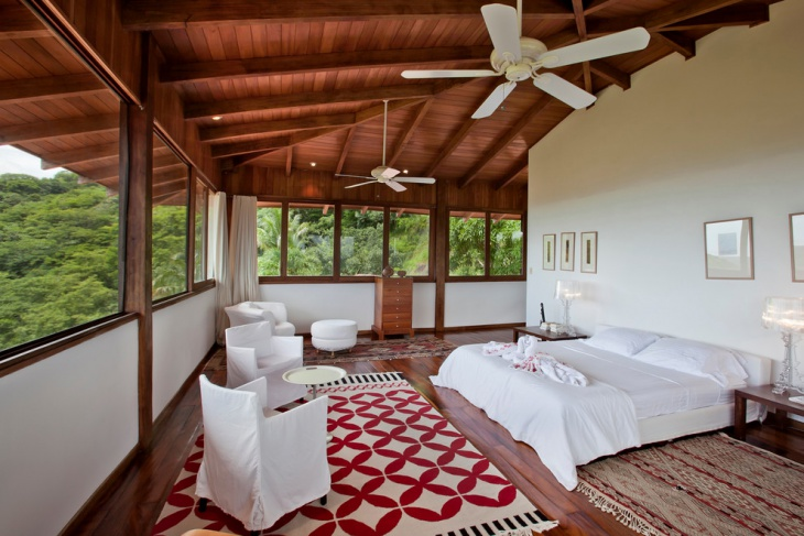 Tropical Bedroom with Wooden Floors and Ceiling