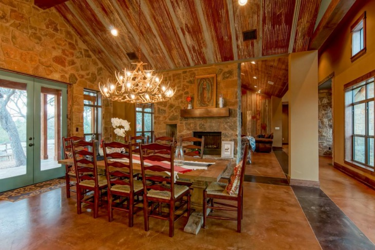 intricate antler chandelier in rustic dining room