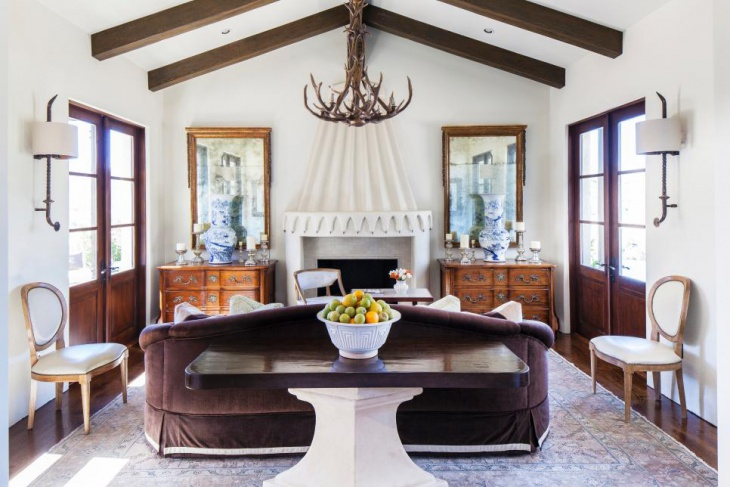 mediterranean living room with wooden antler chandelier