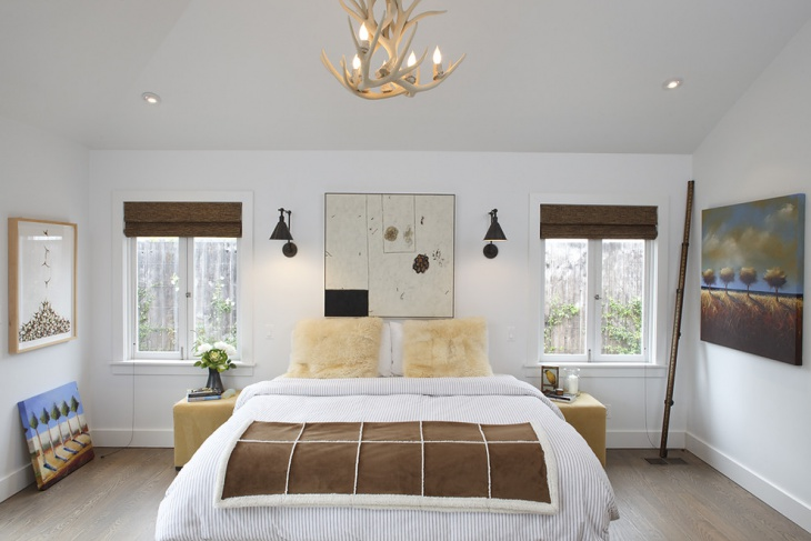 contemporary bedroom with beautiful antler chandelier