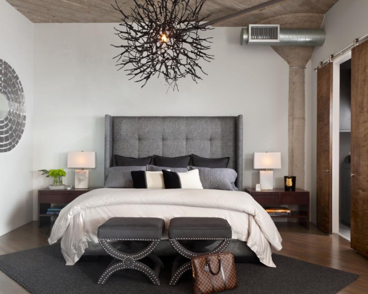trendy master bedroom with artistic metal lights