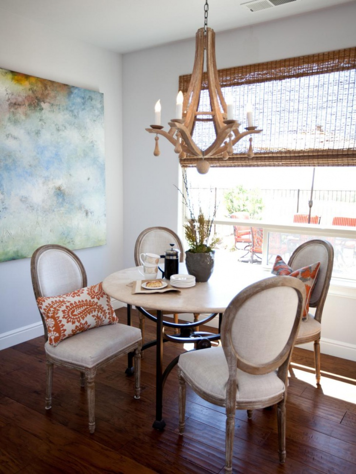 Transitional Dining Room Nook with Simple Wood Chandelier