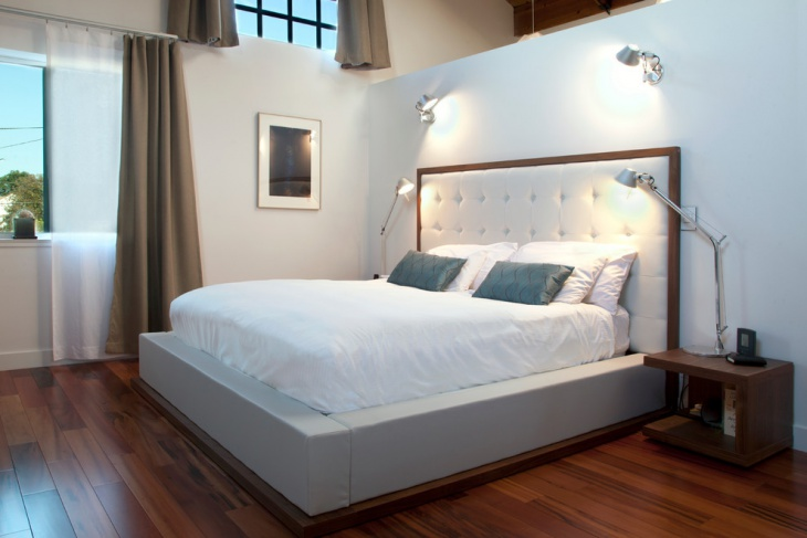 stylish master bedroom with artemide lighting
