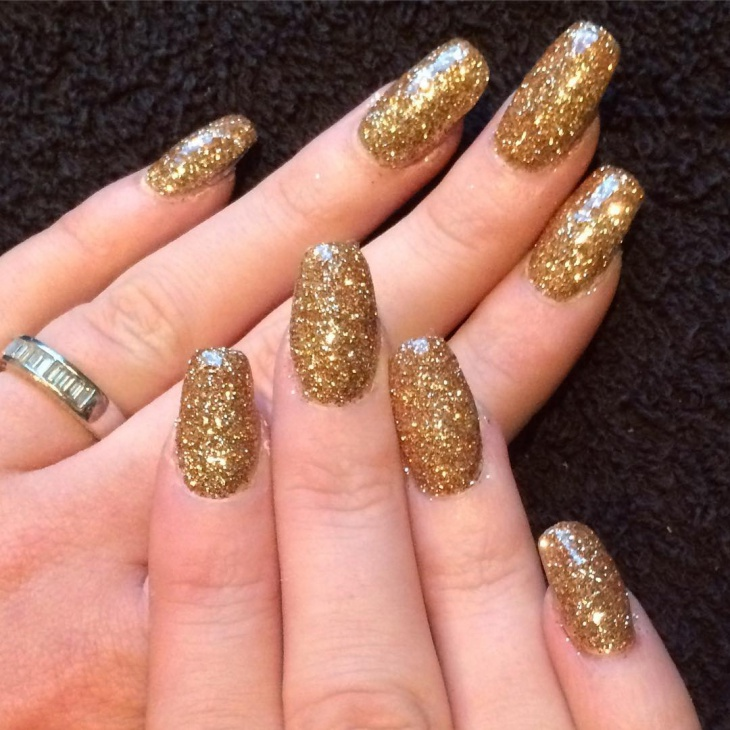 attractive gold glitter nail art