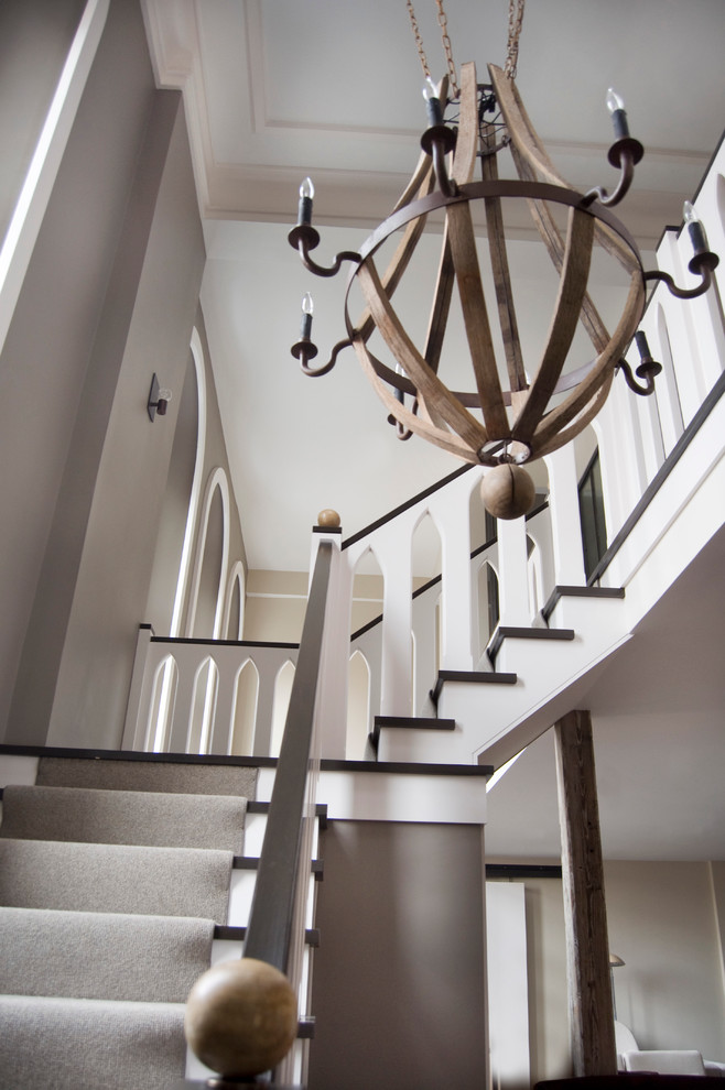 modern staircase with wooden chandeliers