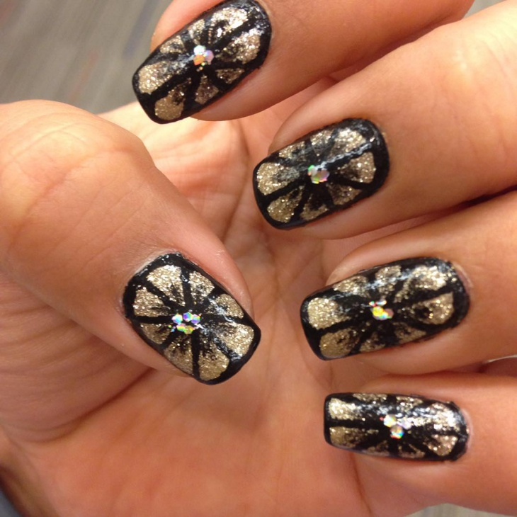 gold and black flower nail design